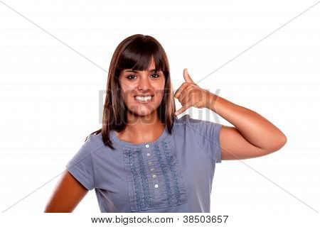 Smiling Young Woman Saying Call Me With Her Hand