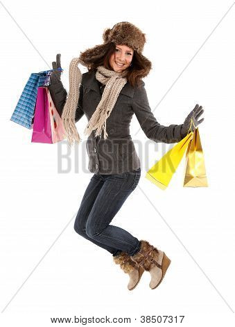Happy Woman With Shopping Bags Jumping