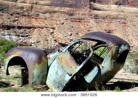 Rusted Junk Car With Bullet Holes