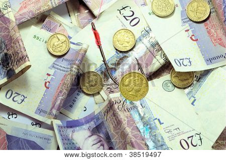 pound coin bait over bed of money