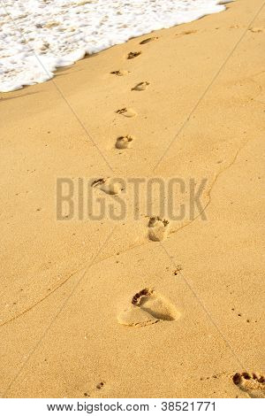 Footprints On Sand Beach