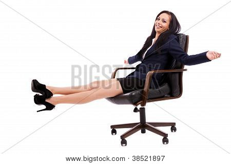 Beautiful Businesswoman Sitting On An Armchair Isolated On White Background