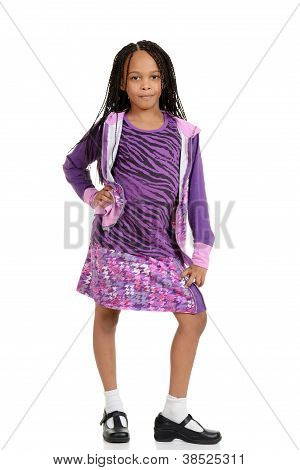 Young child posing in purple outfit