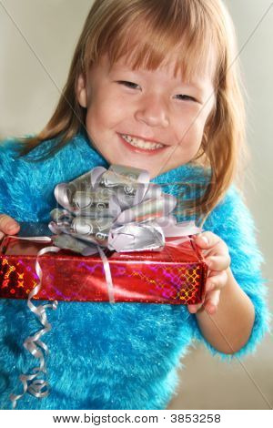 Happy Girl Holding A Gift Box