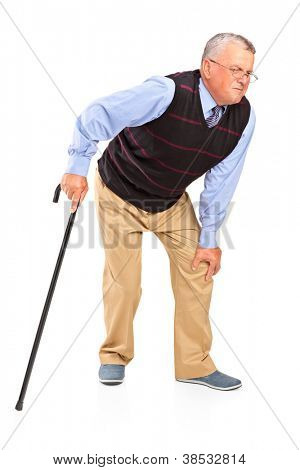 Full length portrait of a mature man with a knee pain isolated on white background