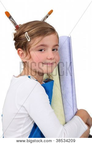 Cute little girl with equipment for home decoration