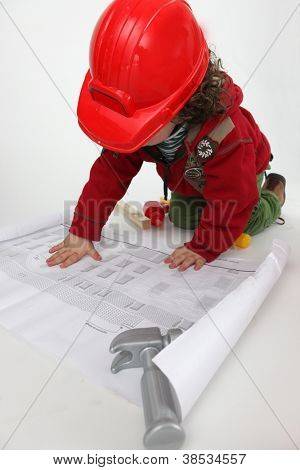 Young child pretending to be a construction worker