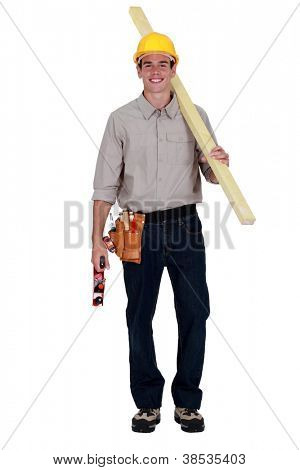 Worker holding a plank of wood and a plane