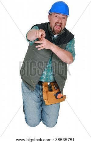 Builder pointing and laughing