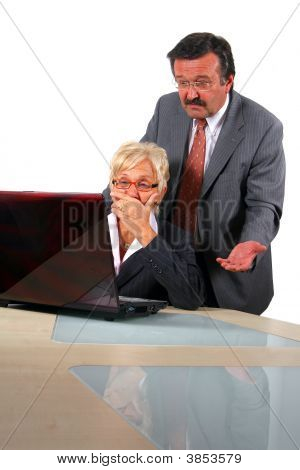Senior Business People In Front Of Laptop