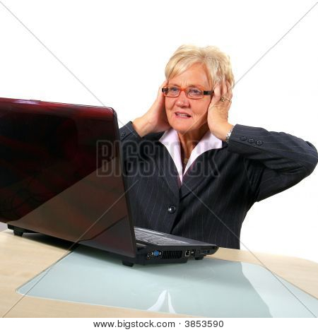 Shocked Senior Business Woman In Front Of Laptop