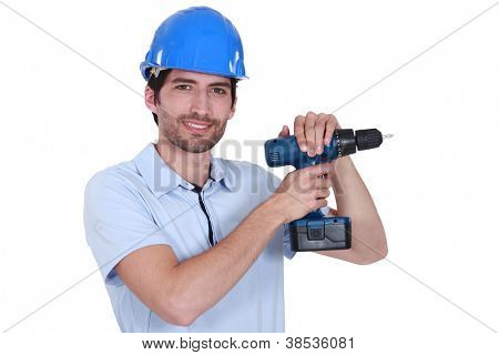 Man with helmet and drill
