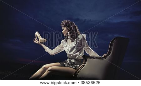 Young woman looking at shoe