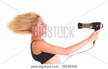 Young female drying hair , isolated on white