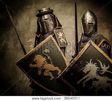 Medieval knights on grey background