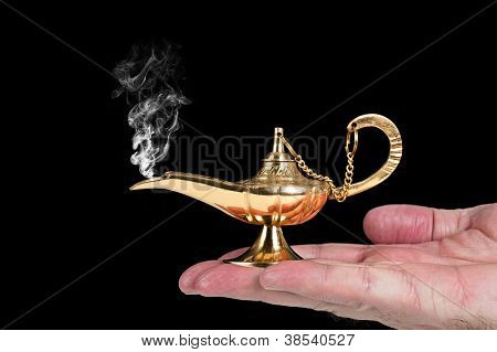A man holds an active magic oil lamp with smoke rising out of it.