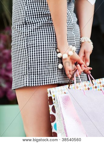 Female hands holding a shopping bags