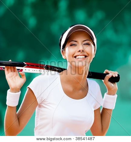 Sportswoman with racquet at the tennis court. Healthy lifestyle