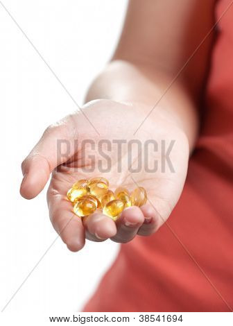 Pills on the hand, isolated on white. Herbal remedy