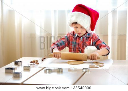 Little Boy With Rolling Pins Baking And Having Fun