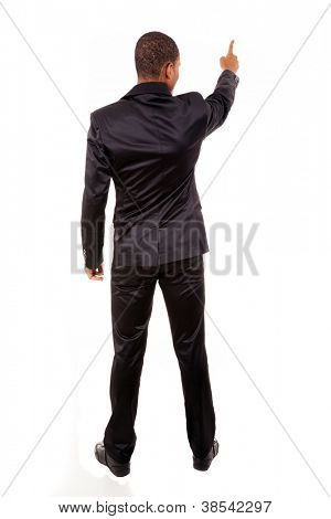 Full length of a African business man pointing at copyspace isolated over white background