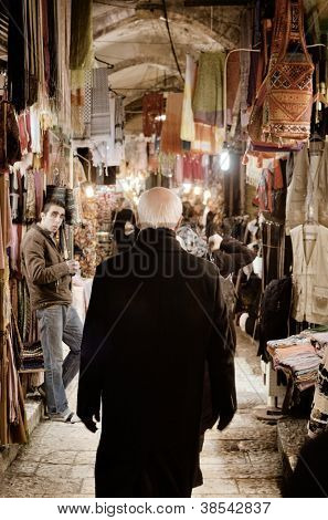 JERUSALEM - FEBRUARY 11: The Shoppers at the Suq February 11, 2012 in Jerusalem, IL. Suqs are traditional middle eastern markets.