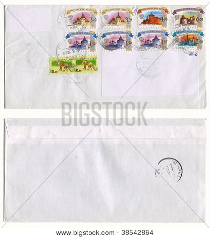 RUSSIA - CIRCA 2012: Mailing envelope with postage stamps dedicated to Russian kremlins and animals, and the reverse side, circa 2012.