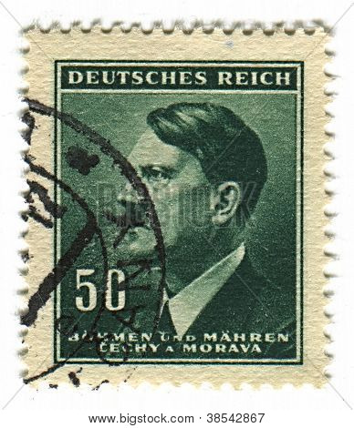 GERMANY - CIRCA 1937: A stamp printed in Germany shows image of Adolf Hitler was an Austrian-born German politician and the leader of the Nazi Party, in green, circa 1937.