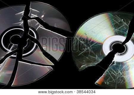 Defective and broken disks with information isolated on black