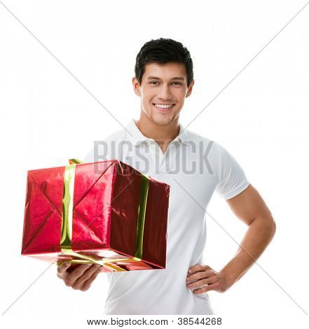Offering a gift wrapped in red paper sporty man, isolated on white