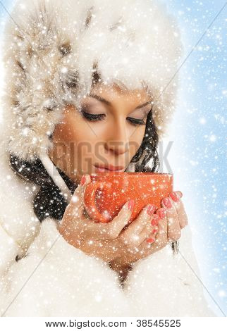 Young and beautiful woman with a red cup