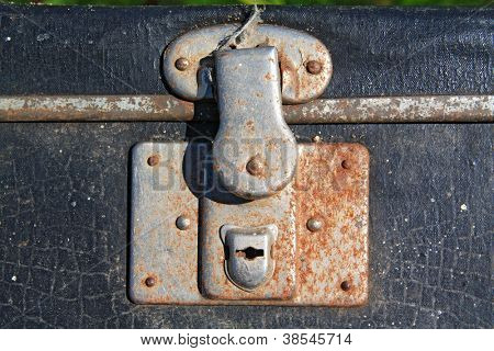 rusty lock on old valise