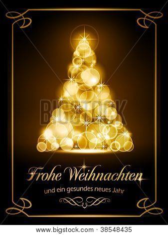 """Warmly sparkling Christmas tree made of our of focus  lights on dark brown background with the text """"Frohe Weihnachten und ein gesundes neues Jahr""""."""