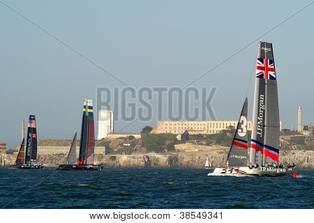 SAN FRANCISCO, CA - OCTOBER 4: The Artemis, Oracle and Ben Ainslie teams sail in front of Alcatraz in the America'??s Cup World Series sailing races in San Francisco, CA on October 4, 2012