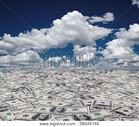 big pile of money. stack of american dollars on the sky backgrounds