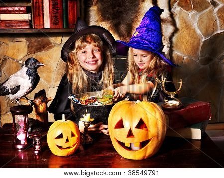 Witch  children with pumpkin lantern. Halloween.