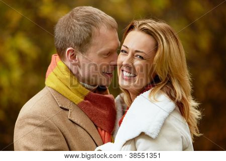 Portrait of happy woman laughing with her date near by