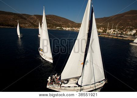 "SARONIC GULF, GREECE - SEPTEMBER 28: Competitors boats during of sailing regatta ""Viva Greece 2012"" on September 28, 2012 on Saronic Gulf, Greece."
