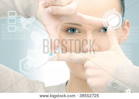 picture of businesswoman creating frame with fingers