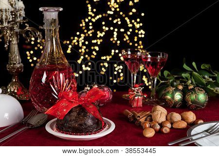 Christmas dinner table with xmas pudding as dessert