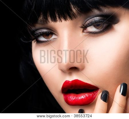 Beautiful Brunette Girl Portrait.Face.Makeup. Sensual Red Lips and Smokey Eyes Make-up