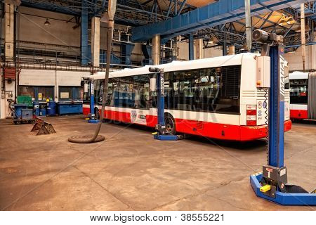 PRAGUE, CZECH REPUBLIC - SEPTEMBER 17: Inspection of chassis of public buses in workshop in Depot Hostivar on Open Doors Day in the Prague Public Transport Company on September 17, 2011 in Prague