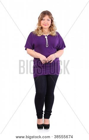 Smiling beautiful woman wearing violet t-shirt stands isolated on white background.