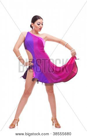 gorgeous young salsa woman dancer holding her dress and looking down arrogantly