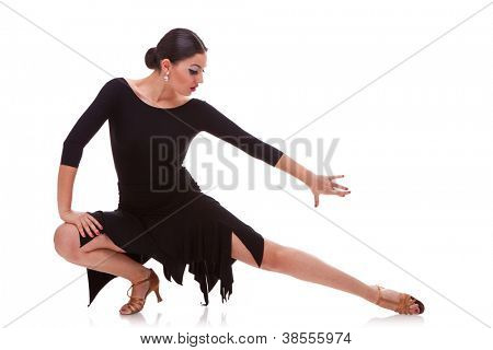 portrait of a young woman salsa dancer in a lunge dance pose. isolated on white background
