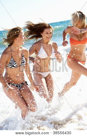 Group Of Teenage Girls Enjoying Beach Together
