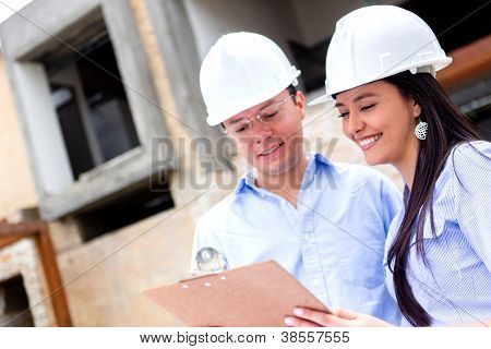 Team of architects working in a construction site