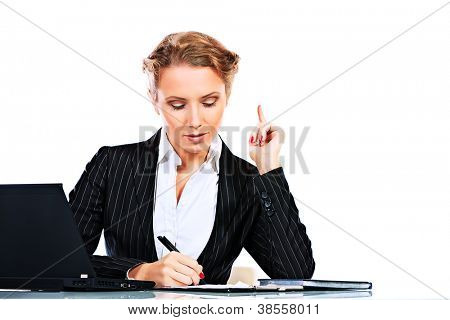 Portrait of a serious businesswoman working on a laptop. Isolated over white.