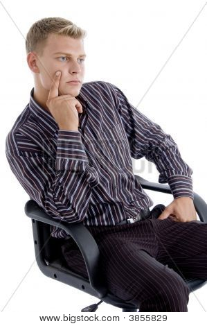Young Caucasian Sitting On Chair Thinking
