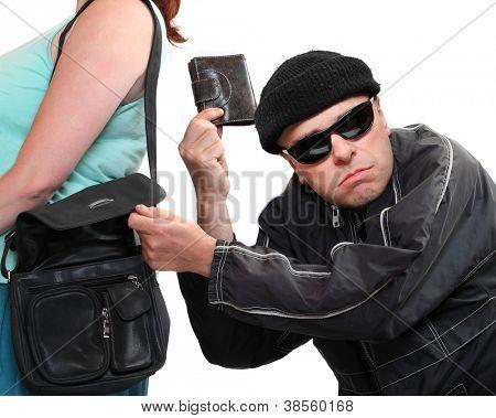 Dieb Diebstahl aus Handtasche einer Frau. Thema Einkaufen. Versicherungs-Konzept.